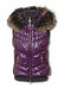 Теплая женская жилетка с лаковым блеском ткани и мехом сверху